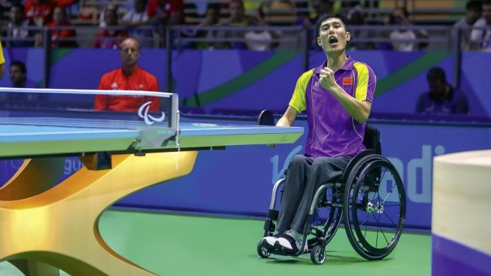 Wheelchair user playing table tennis.