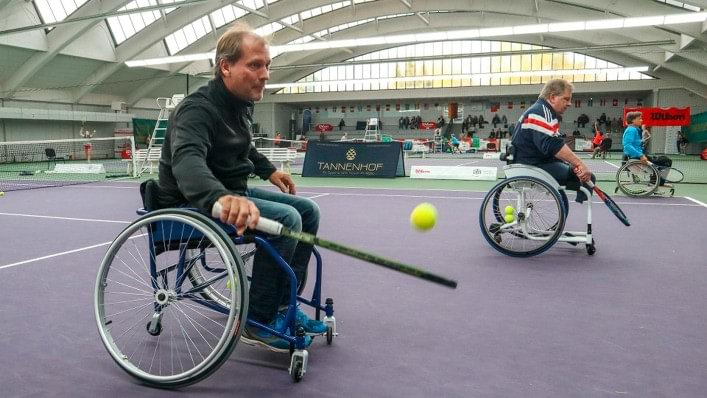 Wheelchair user on tennis court