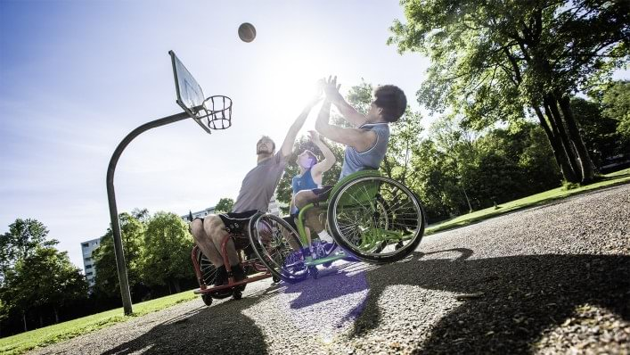 Teenagers play wheelchair basketball
