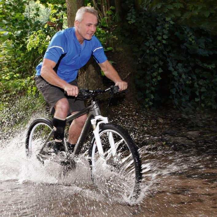 Henning riding a bike with WalkOn Reaction.