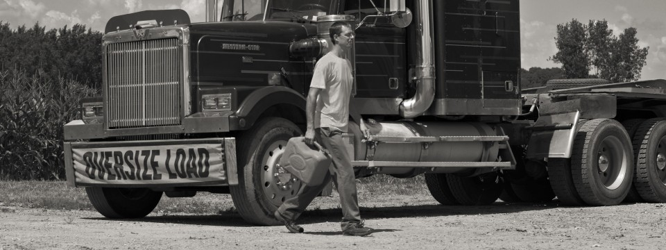 Man carrying a petrol can, wearing a Triton prosthetic foot.