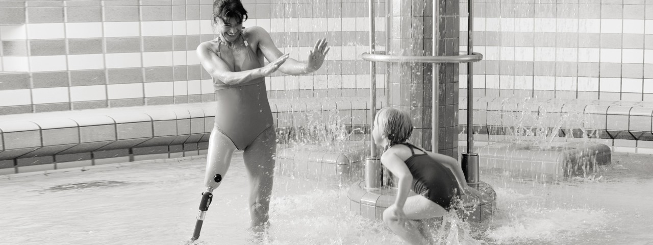 User with Aqualine waterproof prosthesis system at the pool