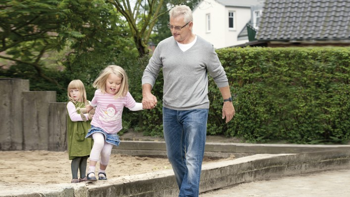 Gerhard with C-Leg prosthesis playing with his grandchildren.