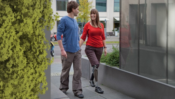 Vanessa with Genium prosthesis walking hand-in-hand with her husband.
