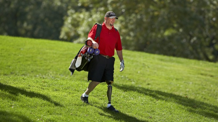 Mike golfing while walking on his Genium.