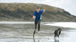 John with Running prosthesis taking a run on the beach.