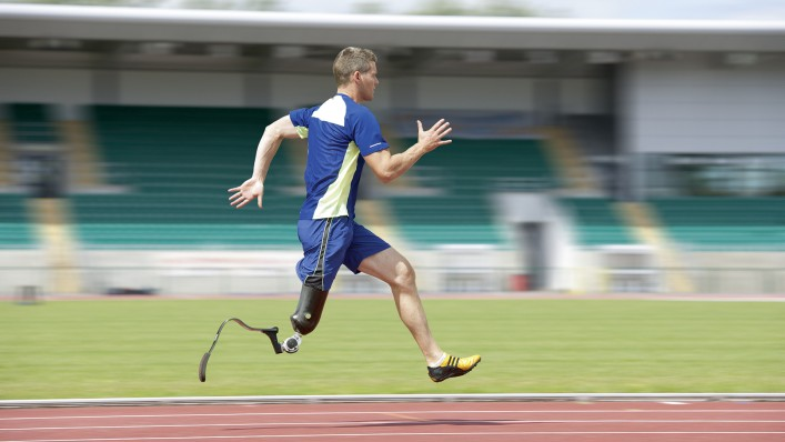 John with Running prosthesis training on a tartan track.