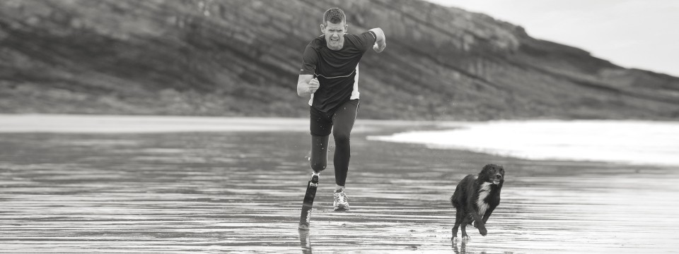John with 3S80 Sports prosthesis taking a run on the beach.