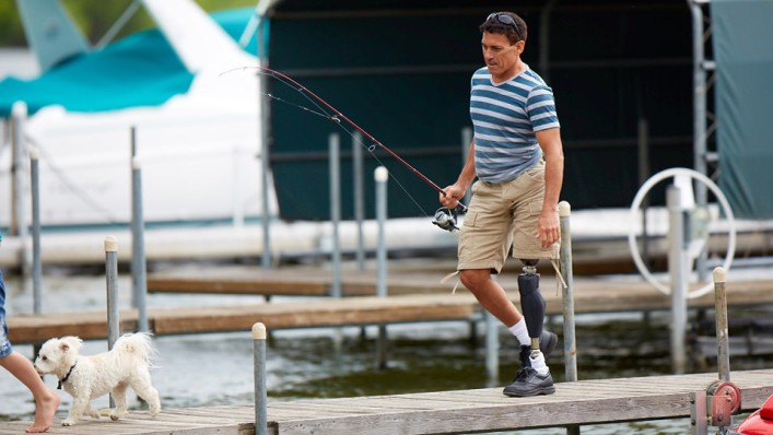 Andrew walking on the dock with his X3 prosthetic leg.