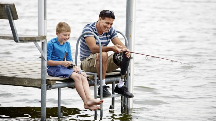 GeniumX3 user fishing with a child