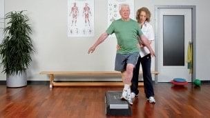 Therapist explains the rehabilitation exercise.