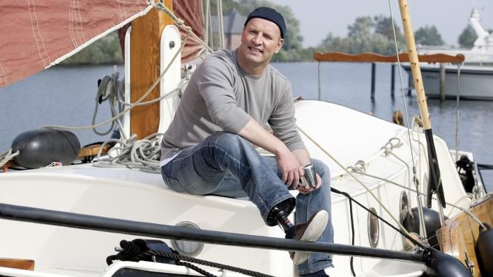Karsten sits on his sailboat and enjoys the day