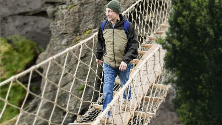 John safely wanders over a bridge